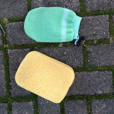Yellow sponge and green face scrubber