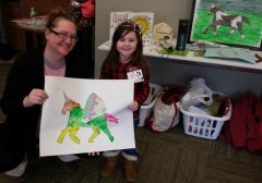 Proud Nana Helps Display Art With Granddaughter
